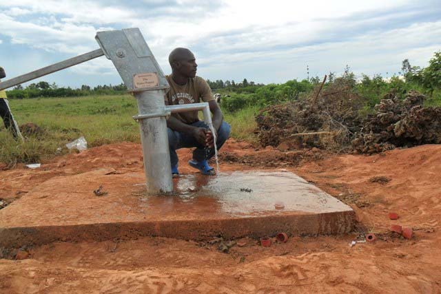 The Water Project : rwanda-3002_page_4_image_0002-2
