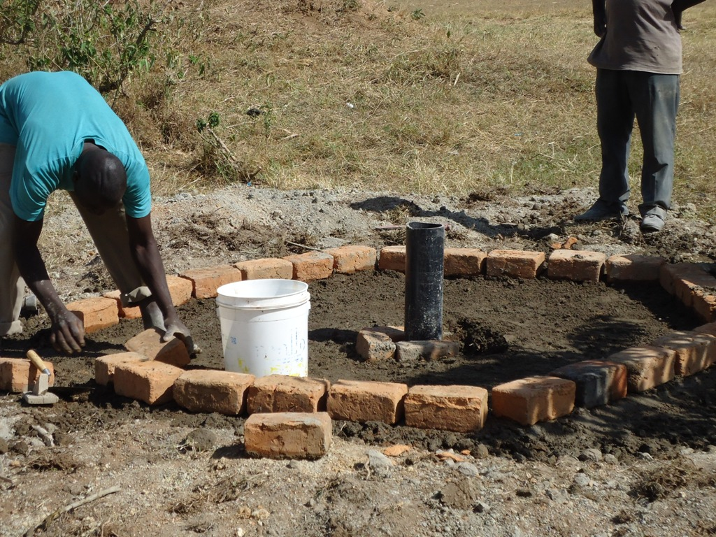 The Water Project : lwanda-k-sec-pad-construction-2