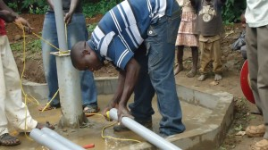 The Water Project : pump-installation-wazee-hukumbuka