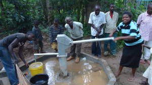 The Water Project : water-flowing-wazee-hukumbuka-001