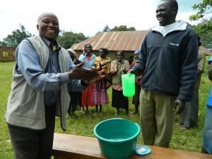 The Water Project : kenya4160-david-showing-how-handwashing-is-done