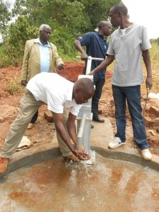 The Water Project : kenya4160-bwp-staff-happy-that-water-is-flowing