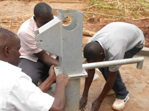 The Water Project : kenya4160-installating-the-pump-2