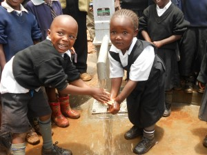 The Water Project : kenya4160-excitement-for-water-flowing
