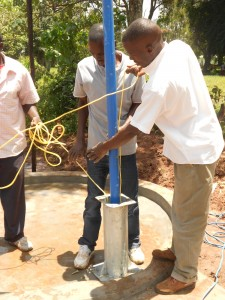 The Water Project : kenya4160-installing-the-pump