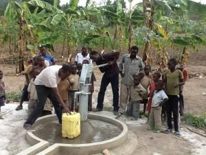 The Water Project : rwanda3066-water-flowing-2