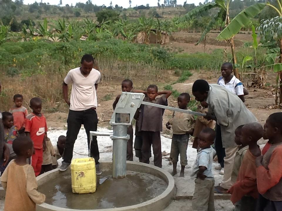 The Water Project : rwanda3066-water-flowing