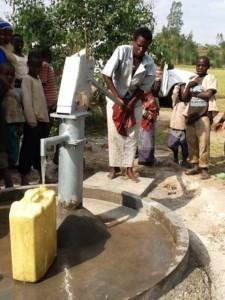 The Water Project : rwanda3067-water-flowing-2