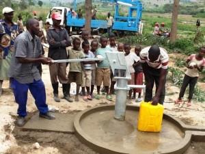 The Water Project : rwanda3069-water-flowing-3