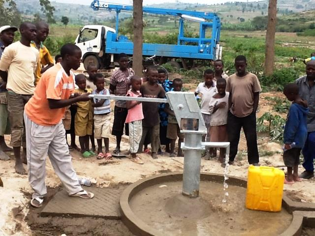 The Water Project : rwanda3069-water-flowing