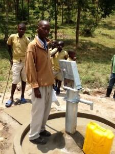 The Water Project : rwanda3070-community-member-1