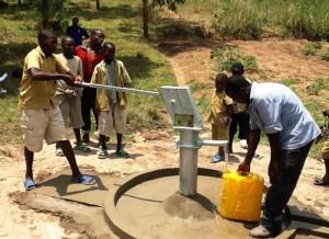 The Water Project : rwanda3070-water-flowing-1