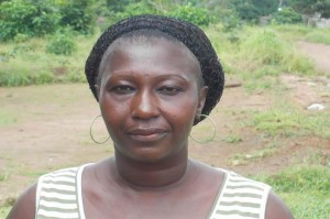 Neneh K - Petty Trader, discussing her newly donated water project in Sierra Leone