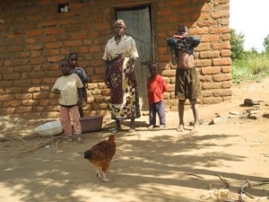 The Water Project : kenya4297-03-first-members-family-outside-her-house