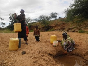 The Water Project : kenya4297-09-members-carry-water-home-on-their-backs