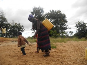 The Water Project : kenya4297-10-members-carry-water-home-on-their-backs
