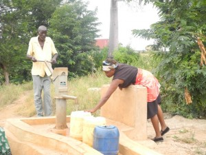 The Water Project : kenya4297-15-members-fetch-water-from-a-well-contructed-close-to-their-sand-dam