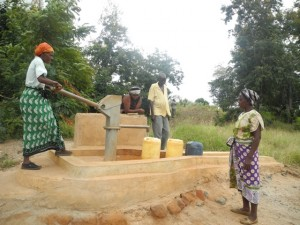 The Water Project : kenya4297-16-members-fetch-water-from-a-well-contructed-close-to-their-sand-dam