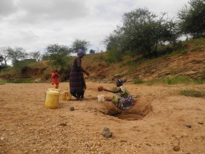 The Water Project : kenya4297-17-members-fetching-water-from-a-scoophole