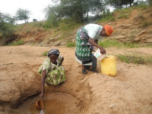 The Water Project : kenya4297-21-members-fetching-water-from-a-scoophole