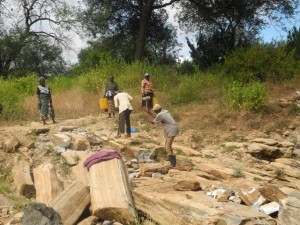 The Water Project : kenya4299-19-members-at-work-at-the-new-dam-site