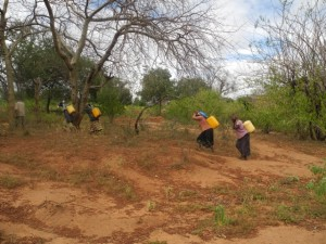 The Water Project : kenya4299-22-members-carry-water-home