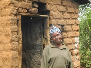 The Water Project : kenya4299-30-second-member-and-kitchen-2