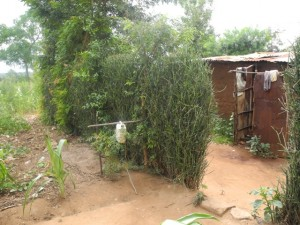 The Water Project : kenya4299-31-second-member-and-kitchen