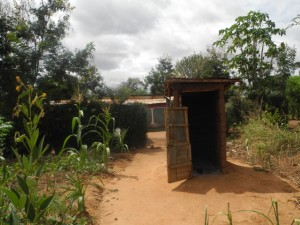 The Water Project : kenya4299-36-second-members-latrine-toppy-tap-and-entarnce-to-home