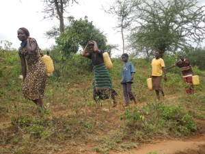The Water Project : kenya4301-35-members-carry-water-home