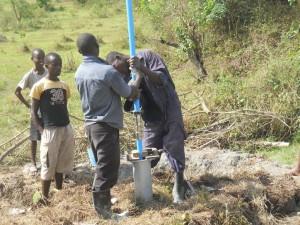 The Water Project : uganda6046-09-kacwangobe-installation-2