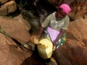 The Water Project : kenya4307-kee-woman-fetching-water-from-a-rock-04