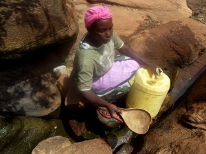 The Water Project : kenya4307-kee-woman-fetching-water-from-a-rock-17
