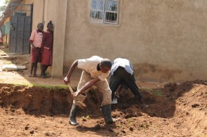The Water Project : kenya4292-05-digging-starts-for-water-tank-construction