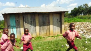The Water Project : kenya4292-12-kids-playing-in-front-of-latrines