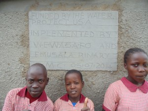 The Water Project : kenya4292-25-pupils-in-front-of-the-newly-constructed-latines-for-girls