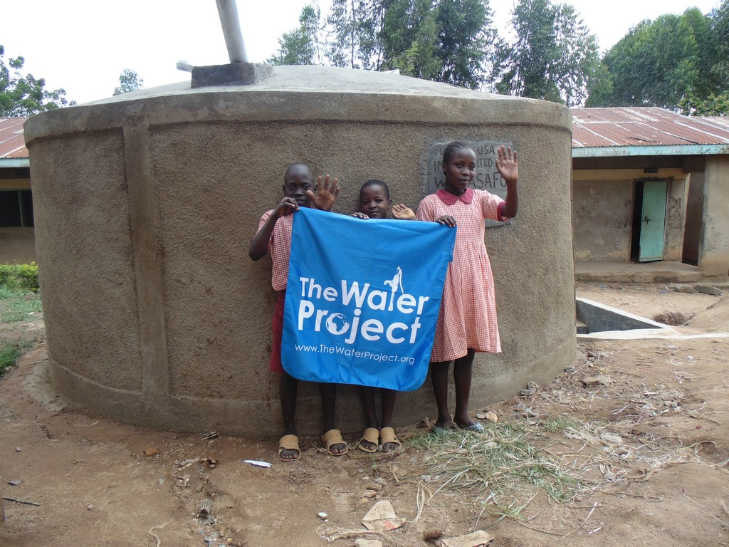 The Water Project : kenya4292-26-in-front-the-completed-tank