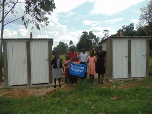The Water Project : kenya4292-27-wash-team-and-pupils-infront-of-girls-and-boys-latrines