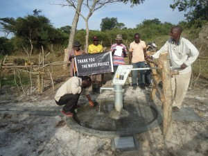 The Water Project : uganda6049-08-some-one-with-clean-water