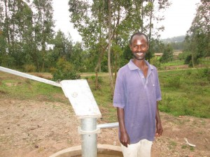 The Water Project : rwanda3080-06-caretaker