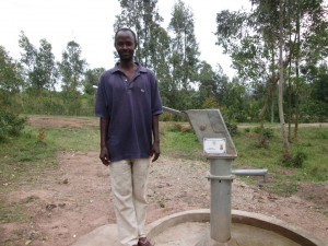The Water Project : rwanda3080-07-caretaker