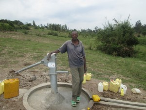 The Water Project : rwanda3081-04-caretaker