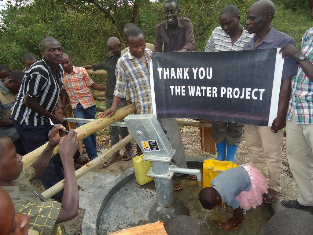 The Water Project : uganda6054-19-person-using-water