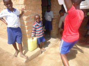 The Water Project : uganda6055-08-classroom-mantainance