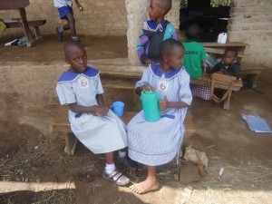 The Water Project : uganda6055-18-sharing-a-packed-drink
