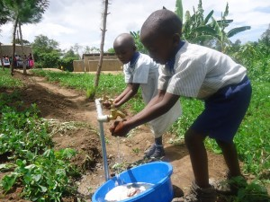 The Water Project : uganda6055-29-some-one-with-clean-water