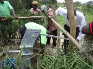 The Water Project : uganda6056-14-community-cleaning-around-the-source