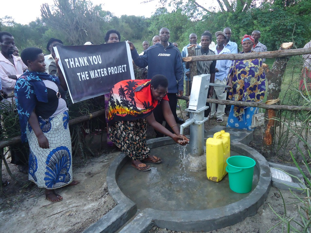 The Water Project : uganda6057-63-some-one-with-clean-water