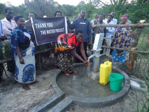 The Water Project : uganda6057-64-some-one-with-clean-water