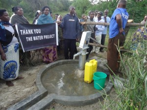 The Water Project : uganda6057-67-some-one-with-clean-water